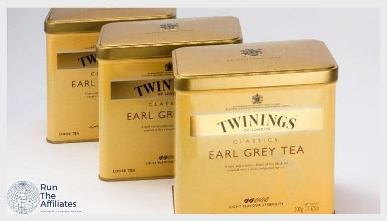 3 gold colored tins of twinings earl grey tea