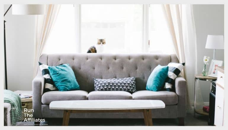 living room with a grey sofa and blue pillows