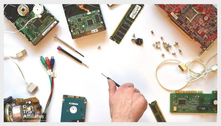 man working with computer components on a white desk top