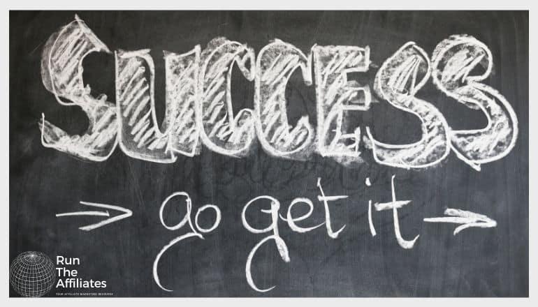 blackboard with success go get it written in chalk