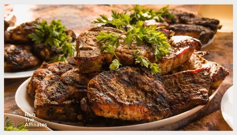 plates of grilled steak stacked with a parsley garnish
