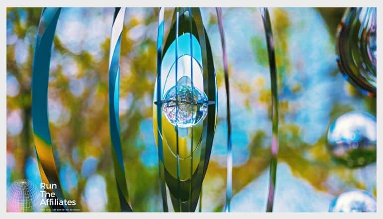 hanging piece of metal art with reflective surfaces fashioned into vertical rings