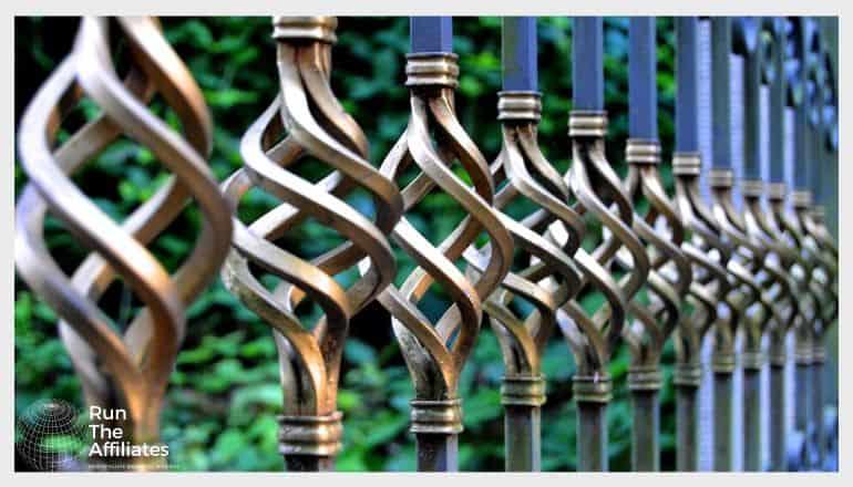 metal art fence posts with corkscrewed metal