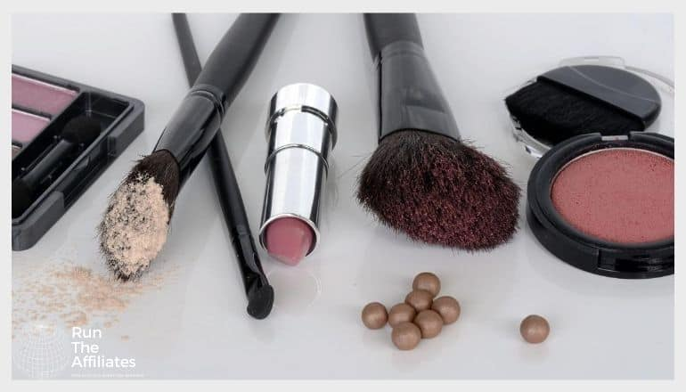 various cosmetic brushes and pads on a table