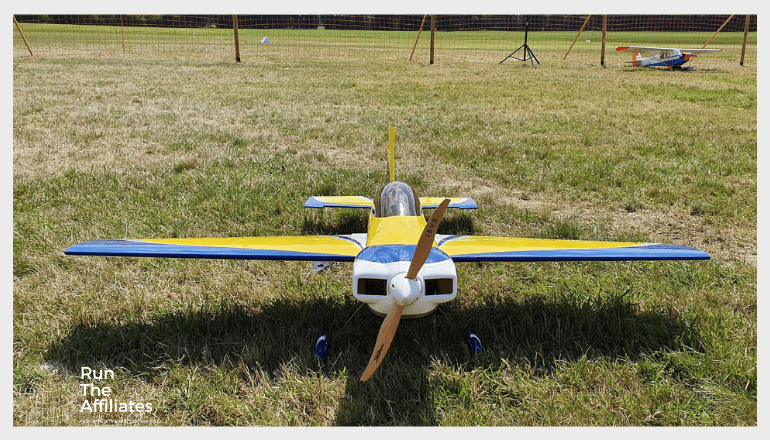 yellow and blue rc plane sitting on grass