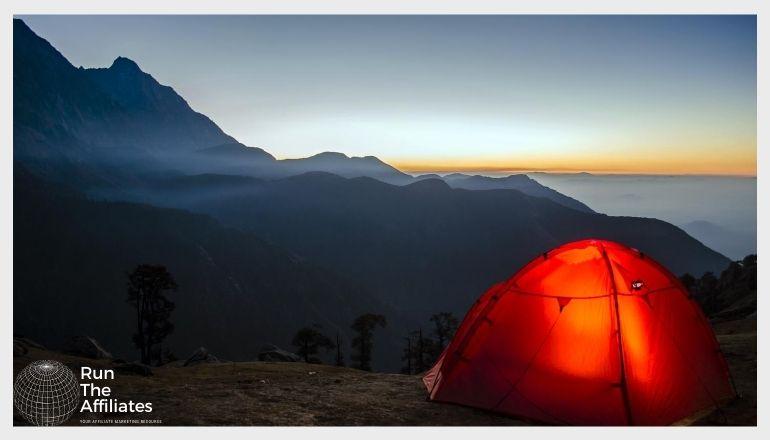 tent illuminated from inside at dusk