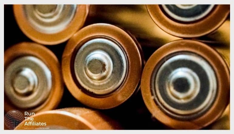 close up of a stack of double A batteries
