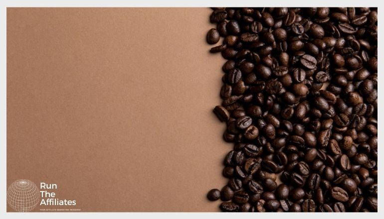 coffee beans spread across the right side of a brown table