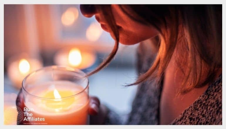 woman holding a candle close to her face