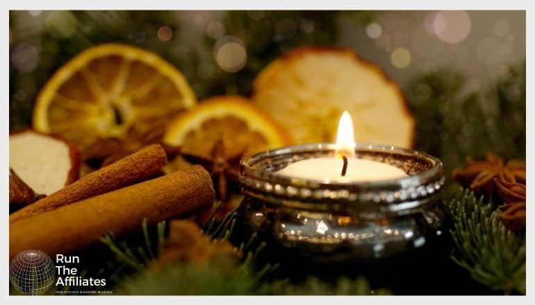 candle surrounded by candied fruit and spices