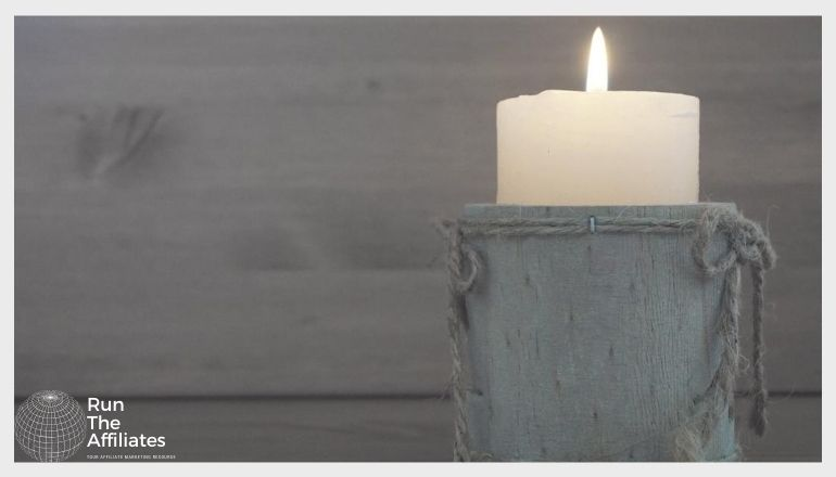 candle in front of a wooden wall