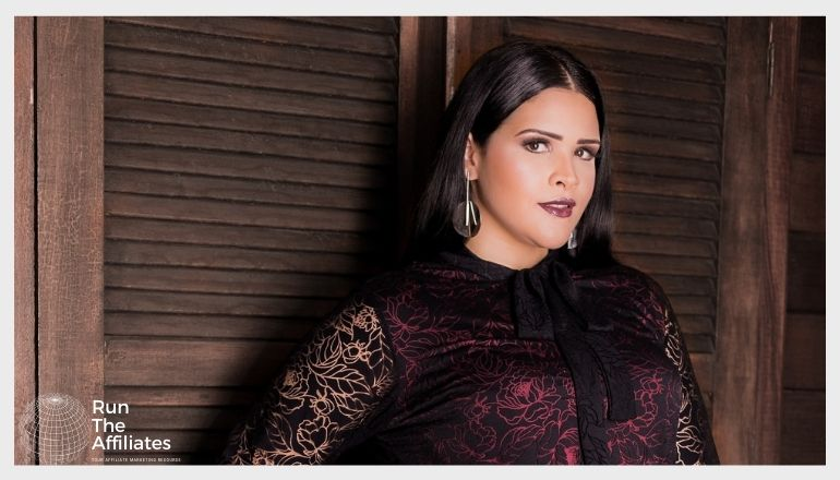 woman with dark hair modeling plus size clothing