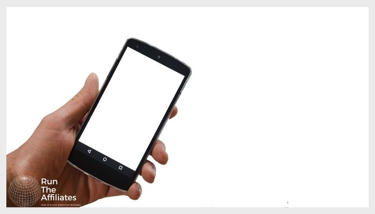 man holding a smartphone against a white background