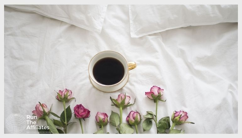 roses and a cup of coffee on a mattress