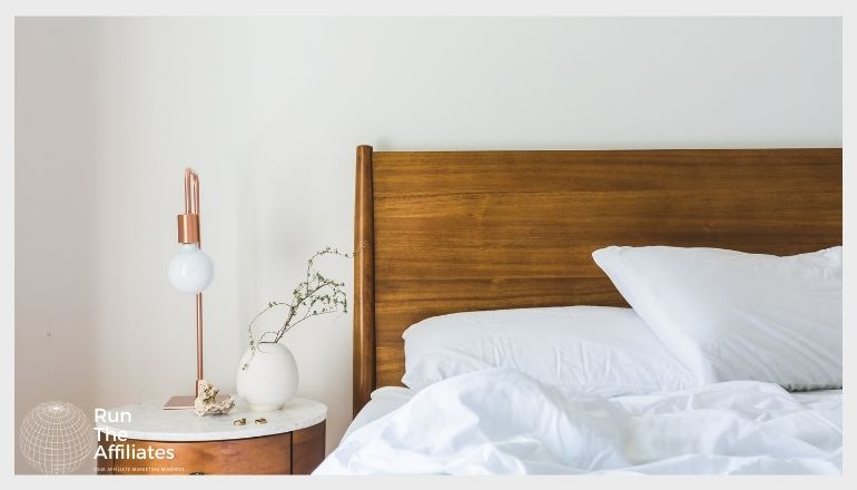 bed with white linen and pillows