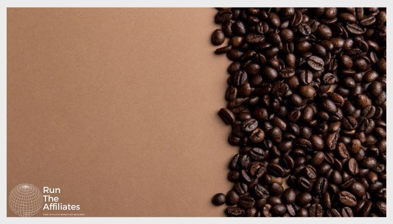 coffee beans on a brown table taking up half the image