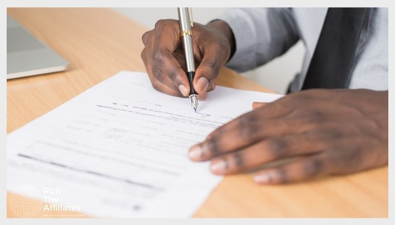man filing out forms